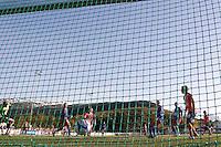 Stranda 20110501. Aalesunds Magnus Sylling Olsen setter ballen forbi keeper Radovan Dvorsky og i mål under cupkampen mellom Stranda og Aalesund i 1. runde av Norgesmesterskapet i fotball for herrer på Stranda Stadion søndag kveld.<br /> Foto: Svein Ove Ekornesvåg