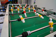 Yellow and red players on a foosball table