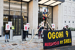 London, UK. 10 November, 2020. Environmental activists from Extinction Rebellion mark the 25th anniversary of the killings of the Ogoni Nine with a vigil outside the Shell Centre. The Ogoni Nine, leaders of the Movement for the Survival of the Ogoni People (MOSOP), were executed by the Nigerian government in 1995 after having led a series of peaceful marches involving an estimated 300,000 Ogoni people against the environmental degradation of the land and waters of Ogoniland by Shell and to demand both a share of oil revenue and greater political autonomy.
