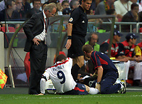 Wayne Rooney (England) receives attention from Gary Lewin for his injured foot,as Manager Sven Goran Eriksson looks cocerned. England v Portugal. Euro Championships 2004. 24/6/04. Credit : Colorsport/Andrew Cowie.