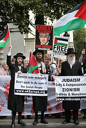 © Licensed to London News Pictures. 09/09/2015. London, UK. Jewish protestors carry pro-Palestinian placards, one depicting Israeli Prime Minister Benjamin Netanyahu, as they gather outside the gates of Downing Street ahead of his visit tomorrow.  Photo credit: Peter Macdiarmid/LNP