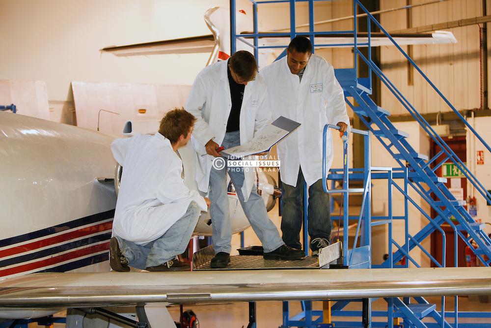 Engineering students working on jet engine