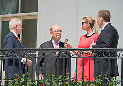 From left to right: United States Attorney General Jeff Sessions, US Secretary of Commerce Wilbur Ross, Ivanka Trump, and US Trade Representative Robert E. Lighthizer, share conversation as they prepare to look at the partial eclipse of the sun from the Blue Room Balcony of the White House in Washington, DC on Monday, August 21, 2017.<br /> Credit: Ron Sachs / CNP