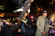 """l to r: Heidi Alberston, American Bald Eagle '' Challenger """" , Russell Simmnons and Jill Henderson at The Life Project for Africa Benefit for the NJIA Health Center in Tanzania, Africa and held at Ben and Jack's Restaurant on November 10, 2009 in New York City"""