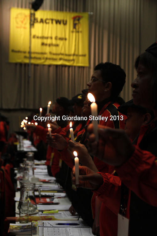 DURBAN - 22 August 2013 - Members of the South African Clothing and Textile Workers Union hold candles during a brief silence to pay tribute to members of the Congress of South African Trade Unions who had lost their lives. The tribute was paid at the 12th National Congress of Sactwu. Picture Allied Picture Press/APP