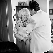Dot Mahoney comforts Shirley Olsen. Ron and Shirley Olsen visit Ivan and Dot Mahoney on Dec. 8, 2010. The wives are in various stages of Alzheimer's Disease, and their husbands look for common ground and support as caretakers in a difficult time.
