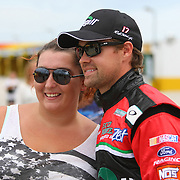 Ricky Stenhouse Jr. poses with a fan as he walks to his garage area during the first practice session of the 56th Annual NASCAR Coke Zero400 race at Daytona International Speedway on Thursday, July 3, 2014 in Daytona Beach, Florida.  (AP Photo/Alex Menendez)