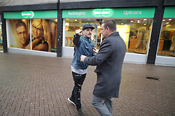 "© Licensed to London News Pictures . 28/01/2017 . Stoke-on-Trent , UK .  Security hold back a protester who calls Paul Nuttall a ""racist scouse twat"" outside the Ukip shop. UKIP formally launch their campaign in the by-election in the constituency of Stoke-on-Trent Central , at their new campaign shop at 1 Piccadilly in Stoke , with candidate - and party leader - Paul Nuttall . The seat was vacated when Tristram Hunt resigned . Photo credit : Joel Goodman/LNP"