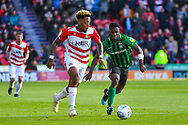 Mallik Wilks of Doncaster Rovers (7) and Brandon Mason of Coventry City (3) in action during the EFL Sky Bet League 1 match between Doncaster Rovers and Coventry City at the Keepmoat Stadium, Doncaster, England on 4 May 2019.