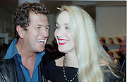 Mario Testino and Jerry Hall. Antonio exhibition Opening. Henry Moore Gallery, Royal College of Art. London. 25 February 1997. © Copyright Photograph by Dafydd Jones 66 Stockwell Park Rd. London SW9 0DA Tel 020 7733 0108 www.dafjones.com