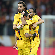 Eskisehirspor's (L-R) Atdhe Nuhiu, Rodrigo Alvaro Tello, Erkan Zengin celebrates his goal during their Turkish Super League soccer match Galatasaray between Eskisehirspor at the TT Arena at Seyrantepe in Istanbul Turkey on Saturday, 06 October 2012. Photo by TURKPIX
