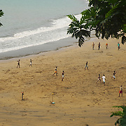 Boys playing in the beach in the south of São Tomé.