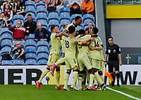 Football - 2021 / 2022 Premier League - Burnley vs. Arsenal<br /> <br /> Martin Odegaard of Arsenal celebrates with his team mates after he curls a free kick around the Burnley wall to put his team 1-0 ahead in the first half, at Turf Moor.<br /> <br /> <br /> COLORSPORT/ALAN MARTIN