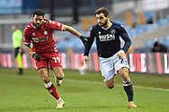 Bristol City midfielder Adrian Mariappa (19) and Millwall forward Mason Bennett (20)  battles for possession during the FA Cup match between Millwall and Bristol City at The Den, London, England on 23 January 2021.