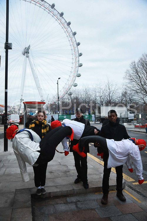 25  young activists from Crazy Talk took to Westminster Bridge and hanged twenty human figures from the bridge to raise awareness to the increased rates of youth suicide in London, January 10th 2019, Central London, United Kingdom. Jaz Holness, Yusef Errami and Ajuub Faraji. The twenty dummies represented the twenty young people between ten and nineteen who took their own lives in London in 2017.<br /> All the young activists involved in the action have either considered or attempted suicide themselves.