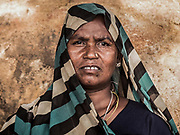 """October 2013. Manbasia. Displaced Forest Dweller. Jharia. """"Now with the dust and smoke bellowing, there are people getting sick. I can't see very well, my chest hurts. My feet hurt and so does my body. It is very painful. We have no one here to help or support us. If someone is dying, there is no one to look after them or save them. Who are we meant to turn to? And if you don't have the money like us, what do we do? Kill ourselves?"""""""