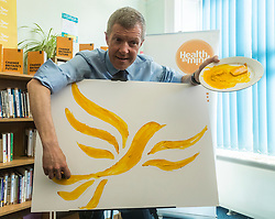 Willie Rennie visits mental health charity, Health In Mind and takes part in painting Liberal Democrat Logos before officially launching the Manifesto for the 2017 General Election.<br /> <br /> <br /> Pictured: Willie Rennie