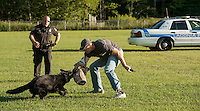 Laconia Police Officer Kevin Shortt commands K9 Jagger during a demonstration with Officer Robb Sedgley during Laconia's National Night Out event at Woodland Heights School Tuesday evening.  (Karen Bobotas/for the Laconia Daily Sun)