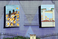 Two lyrical paintings at 905 E. Alisal Street in Salinas grace the side of the building housing El Caporal Family Western Wear.