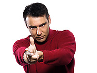 caucasian man gun gesture studio portrait on isolated white backgound