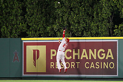 May 18, 2018 - Anaheim, CA, U.S. - ANAHEIM, CA - MAY 18: Mike Trout (27) of the Angels goes up high over the fence to make a catch and bring back a home run but looses the grip on the ball and it comes loose and falls over the fence for a home run by Wilson Ramos of the Rays during the major league baseball game between the Tampa Bay Rays and the Los Angeles Angels on May 18, 2018 at Angel Stadium of Anaheim in Anaheim, California. (Photo by Cliff Welch/Icon Sportswire) (Credit Image: © Cliff Welch/Icon SMI via ZUMA Press)