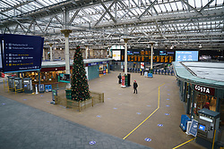 Edinburgh, Scotland, UK. 5 January 2020. Views of a virtually deserted Edinburgh City Centre as Scotland wakes up to the first day of a new strict national lockdown announced by Scottish Government to contain new upsurge in Covid-19 infections. Pic; Waverley railway station is almost empty. Iain Masterton/Alamy Live News