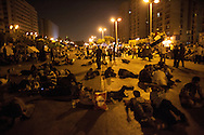 Morsi supporters and Muslim Brotherhood members sleep on streets around a sit-in supporting the president, who was arrested by the military one year after he took office, in response to large opposition demonstrations.