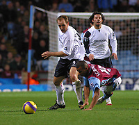 Photo: Dave Linney.<br />Aston Villa v Bolton Wanderers. The Barclays Premiership. 16/12/2006.Villa's  Gabriel Agbonlahor(R) is uphended by Henrik Pedrsen.