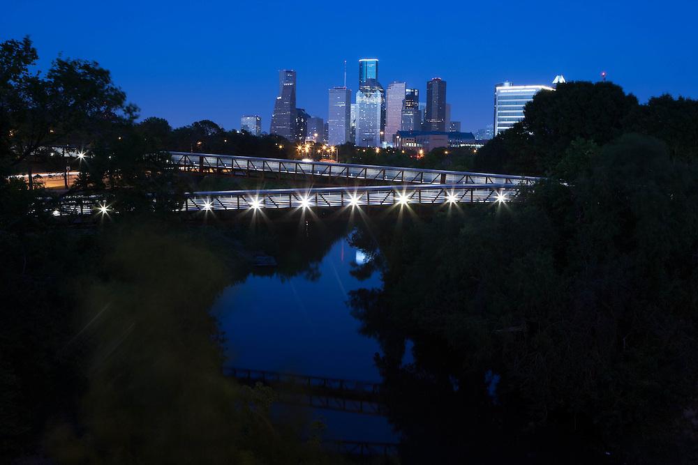 Houston, Texas skyline with Rosemont Bridge over Buffalo Bayou at night.