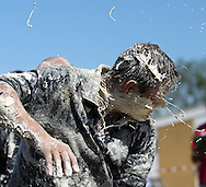 """Coxheath, Kent - Saturday, May 22nd 2010: Jimmy Hickmott, member of winning team """"The High Pressure Cleaning Company"""", suffers a full-face hit in the finals of the World Custard Pie Championships at Coxheath near Maidstone, Kent. The first championship was held in 1967 in Coxheath using a special custard recipe developed by Richard Hearn aka Mr Pastry. The championship is made up of teams competing in heats, semi finals and the final, with the number of pies available per team increasing from 5 in the heats to 10 in the final. 6 points are scored for a direct hit on the face, 3 points for the shoulders or upwards, 1 point for any other part of the body, and points are deducted for misses. A discretionary 5 points can be awarded for the most amusing and original throwing technique. The event is part of the Rotary Club funday. (Pic by Andrew Tobin/SLIK Images)"""
