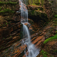 New England waterfall photography of Avalanche Falls at Flume Gorge in the Franconia Notch State Park of the New Hampshire White Mountains.<br /> <br /> Gorgeous New England waterfall photography of Avalanche Falls at the Flume Gorge in the New Hampshire White Mountains Franconia Notch State Park are available as museum quality photography prints, canvas prints, acrylic prints, wood prints or metal prints. Fine art prints may be framed and matted to the individual liking and interior design decorating needs:<br /> <br /> https://juergen-roth.pixels.com/featured/avalanche-falls-at-franconia-notch-state-park-juergen-roth.html<br /> <br /> Good light and happy photo making!<br /> <br /> My best,<br /> <br /> Juergen