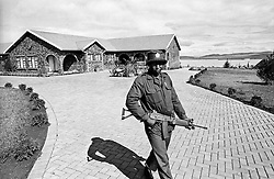 Guards at Nelson Mandela's home in Qunu, Transkei, Eastern Cape. The house was modelled on the prison house he spent the last years of his incarceration in, simply because he could find his way around in the dark, he said. Photo Greg Marinovich.