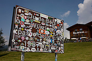 Stickers cover the signpost marking the summit of the Wurzjoch Pass, on the road between Brixen-Bessanone and St Martin in Badia.
