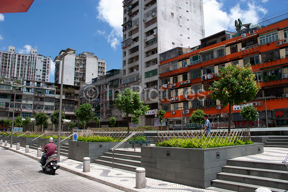 Street scene in Macau, China. Macau is an autonomous region on the south coast of China, across from Hong Kong. A Portuguese territory until 1999, it reflects a mix of cultural influences.