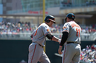 Chris Davis #19 of the Baltimore Orioles shakes the hand of third base coach Bobby Dickerson #11 after hitting a home run against the Minnesota Twins on May 12, 2013 at Target Field in Minneapolis, Minnesota.  The Orioles defeated the Twins 6 to 0.  Photo: Ben Krause
