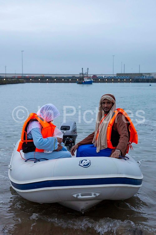 To mark the UN International Migrants Day on 18th December 2020, Folkestone community members staged a Nativity scene with Jesus, Mary and Joseph arriving as refugees in a RHIB boat into the harbour on the 12th of December 2020 in Folkestone, United Kingdom.  Although they were dressed as Mary and Joseph and appeared to have the baby Jesus with them, they were in fact Rishan and Grmalem, an Ambassador and a Trainee with Kent Refugee Action Network. Both are Christians and refugees from Eritrea. Whilst Jesus was, in fact a doll.