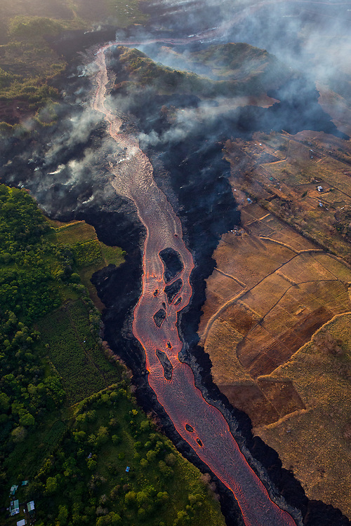 Kilauea's east rift zone: The channelized flow continues downstream, rounding the bend at Four Corners, and entering the sea at Kapoho.