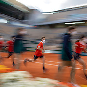 PARIS, FRANCE October 07.  Ball boys and girls and line judges leave the court during a staff change over on Court Philippe-Chatrier during the French Open Tennis Tournament at Roland Garros on October 7th 2020 in Paris, France. (Photo by Tim Clayton/Corbis via Getty Images)