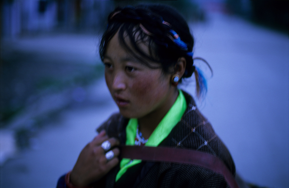 Tibetan woman at dusk, Tibet.