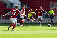 Exeter City's Archie Collins (10) is in mid air during the EFL Cup match between Bristol City and Exeter City at Ashton Gate, Bristol, England on 5 September 2020.