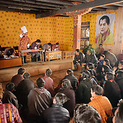 Activities and discussions during a tender offer at the Laya community home, where future road construction works are split amongst local contractors.