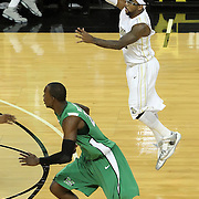 Central Florida guard Marcus Jordan (5) passes during a Conference USA NCAA basketball game between the Marshall Thundering Herd and the Central Florida Knights at the UCF Arena on January 5, 2011 in Orlando, Florida. Central Florida won the game 65-58 and extended their record to 14-0.  (AP Photo/Alex Menendez)