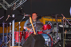 20 September 2014:   Jeff Young<br /> <br /> Marc Boon and the Unknown Legends perform at the Chris Brown Benefit Concert at the Corn Crib Stadium, Normal Illinois.  The band is comprised of 8 musicians: Marc Boon - front man and lead guitar, Jeff Young - drums, Ray Wiggs- keyboards, Aaron Garcia - trumpet-percussion-vocals, Burl Torner - guitar, Russell Zehr - saxaphone-guitar-keyboards-vocals, Chris Briggs - bass-vocals-keyboard, Jerry Abner - keyboards,