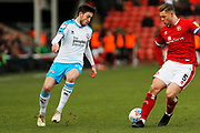 Ashley Nadesan takes on James Clarke during the EFL Sky Bet League 2 match between Walsall and Crawley Town at the Banks's Stadium, Walsall, England on 18 January 2020.