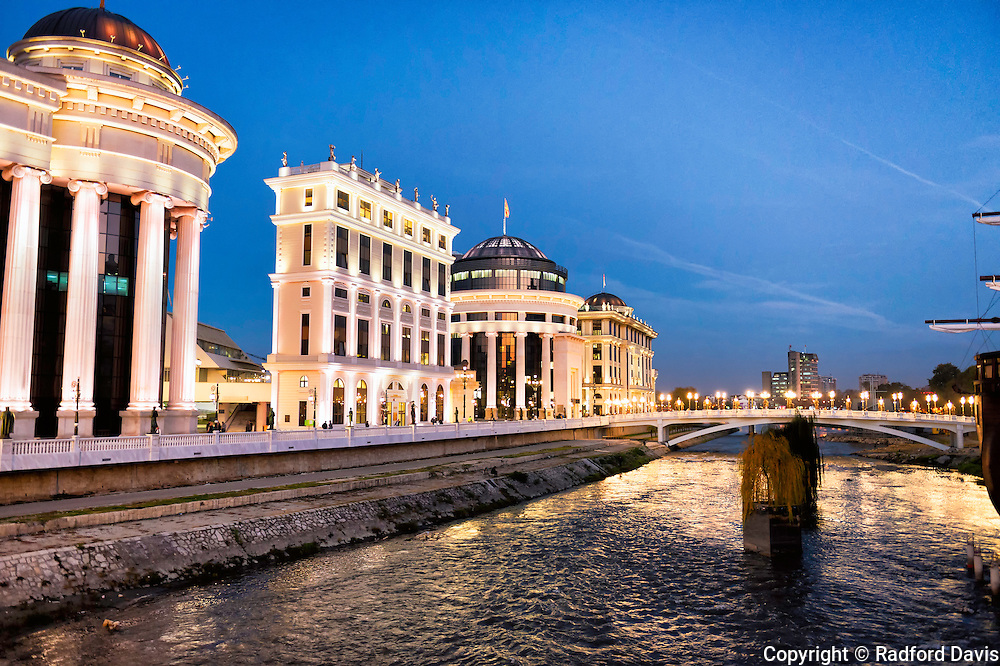 Bridge and buildings in the twilight of Skopje, Macedonia