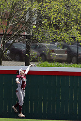22 April 2017:  Erika Velasquez Zimmer loses her glove over the wall while trying to snag a homerun hit by Jordan de los Reyes during a Missouri Valley Conference (MVC) women's softball game between the Missouri State Bears and the Illinois State Redbirds on Marian Kneer Field in Normal IL