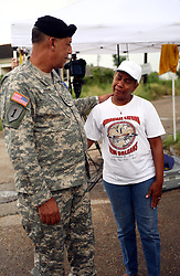 29 August  2007. Lower 9th Ward, New Orleans, Louisiana. <br /> Lieutenant General Russel L. Honore, the army commander who came to New Orleans and took charge during the darkest days following the devastation of Hurricane Katrina tries to answer questions from tearful former resident Valeria Schexnayder. Honore revisits the mainly deserted, still decimated Lower 9th Ward on the Second anniversary of Hurricane Katrina. The area remains mostly abandoned and overgrown with grass growing in the streets. President Bush came to town and claimed he could be proud of what local and federal government have achieved in the city. Yet two years after the storm, it is quite clear that local and federal government are failing and have a great deal to do to live up their promises.<br /> Photo credit©; Charlie Varley/varleypix.com