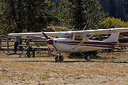 A couple from Germany came to America, purchased this Cessna 152, and were spending a year flying it around the United States and visiting various airshows and tourist areas. Here they are landed at Sulphur Creek, ID.