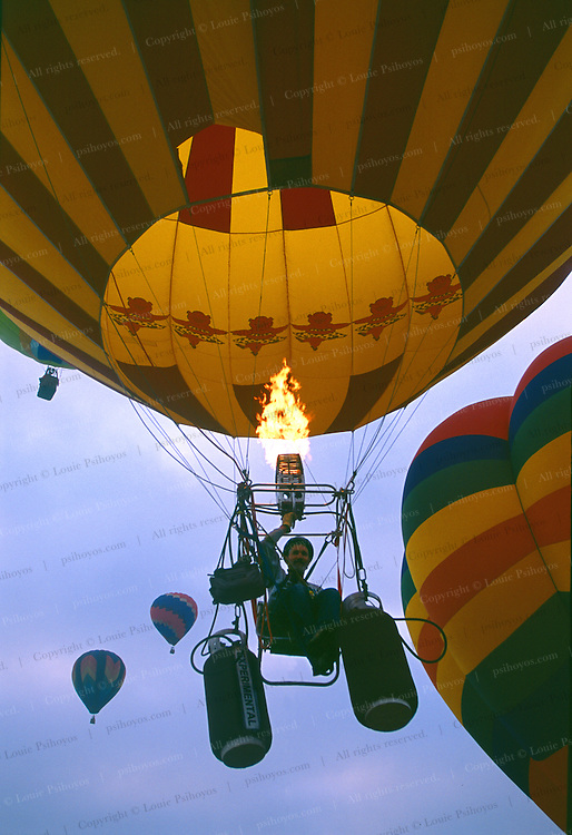 Experimental balloonist Bob Nungester of Cupertino rises in his lawn chair near Coalinga, California.  FAA regulations govern experimental aircraft flights like these which must take place away from high trafficked areas.