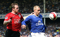 Photo: Paul Thomas.<br /> Everton v Manchester United. The Barclays Premiership. 28/04/2007.<br /> <br /> Wayne Rooney (L) of Utd battles with Tony Hibbert.